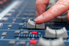 Selective focus finger tuning of sound mixer Stock Photo