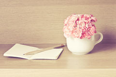 Selective focus of Fresh pink carnation flower with note book on Royalty Free Stock Photos