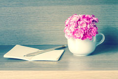 Selective focus of Fresh pink carnation flower with note book on Stock Image
