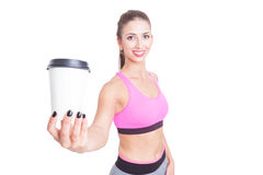 Selective focus of girl at gym holding coffee Stock Photography