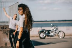 Selective focus of girlfriend and boyfriend. With classical motorbike stock photos