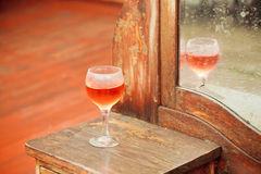Selective focus on glass of wine and vintage furniture Stock Photos
