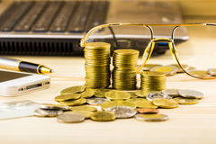 The selective focus of golden coins and the accessory of business,wa Royalty Free Stock Photo