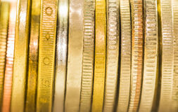 The selective focus golden coins and coins stacked on each other in Royalty Free Stock Images