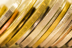 The selective focus golden coins and coins stacked on each other in Royalty Free Stock Photography