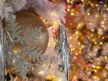 The selective focus on a golden color ball decoration on christm Stock Photography