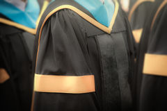 Selective focus on gowns of bachelor degree graduates in commenc Royalty Free Stock Images