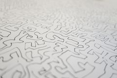 Selective focus of a graphite line drawing of a maze like art pa royalty free stock photos