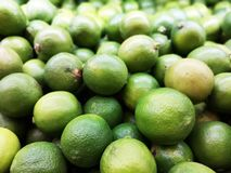 Selective focus of green lemon stock photo