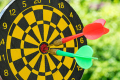 Selective focus on a green and red darts pin in the center of da Royalty Free Stock Image