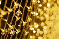 Selective focus on group of led lights decoration in celebration event with glittering bokeh lights in background.  royalty free stock photos