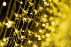 Selective focus on group of led lights decoration in celebration event with glittering bokeh lights in background.  stock photography