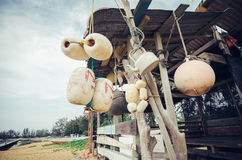 Selective focus group of white buoy tied with rope, hanging under wooden cottage Stock Photography