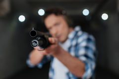 Selective focus of a gun muzzle. Ready to fire. Selective focus of a gun muzzle directed at you while being ready to shoot Royalty Free Stock Photography