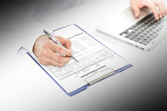 Selective focus at hand of Doctor checking new patient history f Royalty Free Stock Photography
