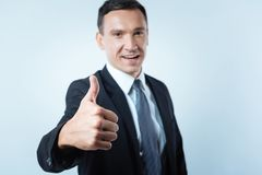 Selective focus of a hand showing thumbs up gesture Stock Photos