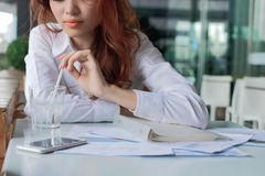 Selective focus on hands of business woman drinking water between break in office.  Royalty Free Stock Photos