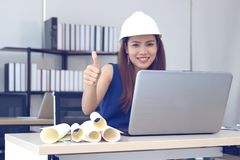 Selective focus on hands of young Asian business woman showing thump up on the workplace in office royalty free stock photography