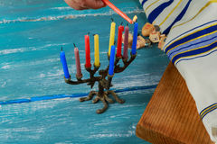 Selective focus of the Hanukkah Jewish holiday with traditional menorah, donuts Stock Photos