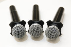 Selective focus on head microphones place on white table in blur Royalty Free Stock Photos
