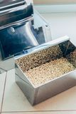 selective focus of heap of grains in container in modern agro stock photo