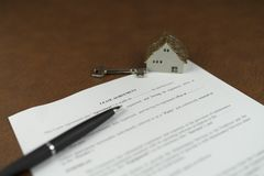 Selective focus of home lease agreement with key stock photo