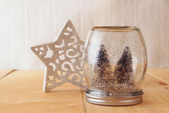 Selective focus image of christmas trees in mason jar. Royalty Free Stock Images
