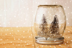 Selective focus image of christmas trees in mason jar. glitter overlay Stock Image