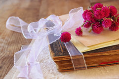 Selective focus image of dry flowers and old vintage books on wooden table. retro filtered image Royalty Free Stock Image