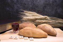 Selective focus at jesus spell and bread with grape juice with crucifix stock photo