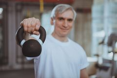 Senior man working out at the gym royalty free stock photography