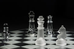 Selective Focus on King. Kings facing each other with one with selective focus and the other in the background, Queen and Knight on the board Stock Image