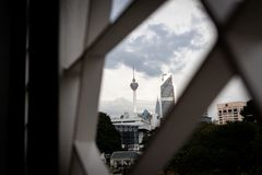 Selective focus of Kuala Lumpur Tower framed by modern ornament design stock photos