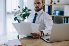 selective focus of lawyer with papers at workplace stock photos