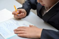 Selective focus of little boy learning how to write his name, Kid study at home, Children do homework at home, Concept for toddler. Learn about writing the stock photography