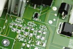 Selective focus macro closeup of computer circuit board componen Stock Photos