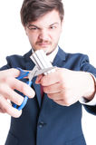 Selective focus of mad man cutting cigarettes Royalty Free Stock Image
