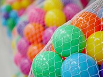 Selective focus of many colorful plastic balls in nets in different colors stock photos