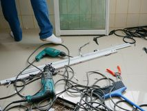 Messy on-the-field floor where technicians installing sliding window for an apartment. Selective focus of messy on-the-field floor where technicians were stock photo