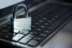 Selective focus on metal lock on keyboard password internet onli Royalty Free Stock Photography