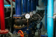 Selective focus on the meter gauge for pressure measurement of the water pipe system.  stock photo
