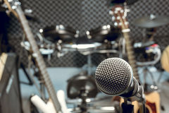 selective focus microphone and blur musical equipment guitar ,bass, drum piano background. stock image