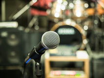 Selective focus on microphone with blurry music studio background Stock Photos