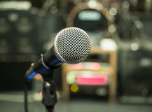 Selective focus on microphone with blurry music studio background Royalty Free Stock Image
