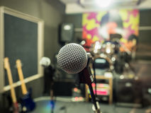 Selective focus on microphone with blurry music studio background Royalty Free Stock Photos