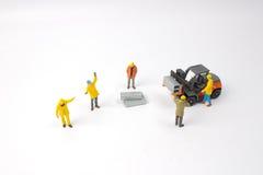 Selective focus of miniature worker Stock Photos