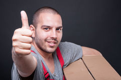 Selective focus of mover guy holding box showing like Stock Photo