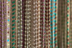 Selective focus of necklace accessories of woman. Royalty Free Stock Photos