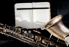 Selective focus notebook and saxophone Stock Image