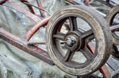 Selective focus of old wheel carts. Close up with place for your text Royalty Free Stock Image